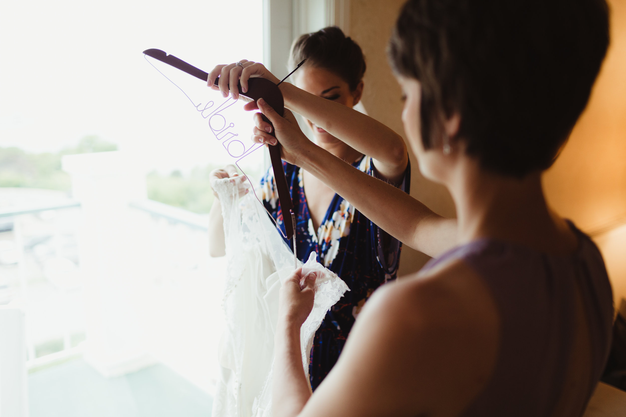 maid of honor helping into dress