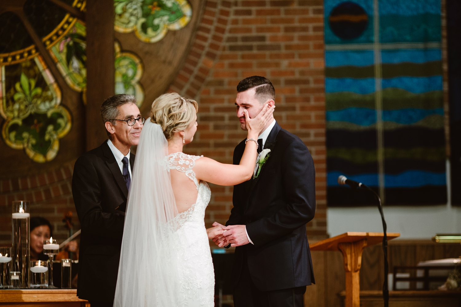 groom crying during vows at midwest wedding