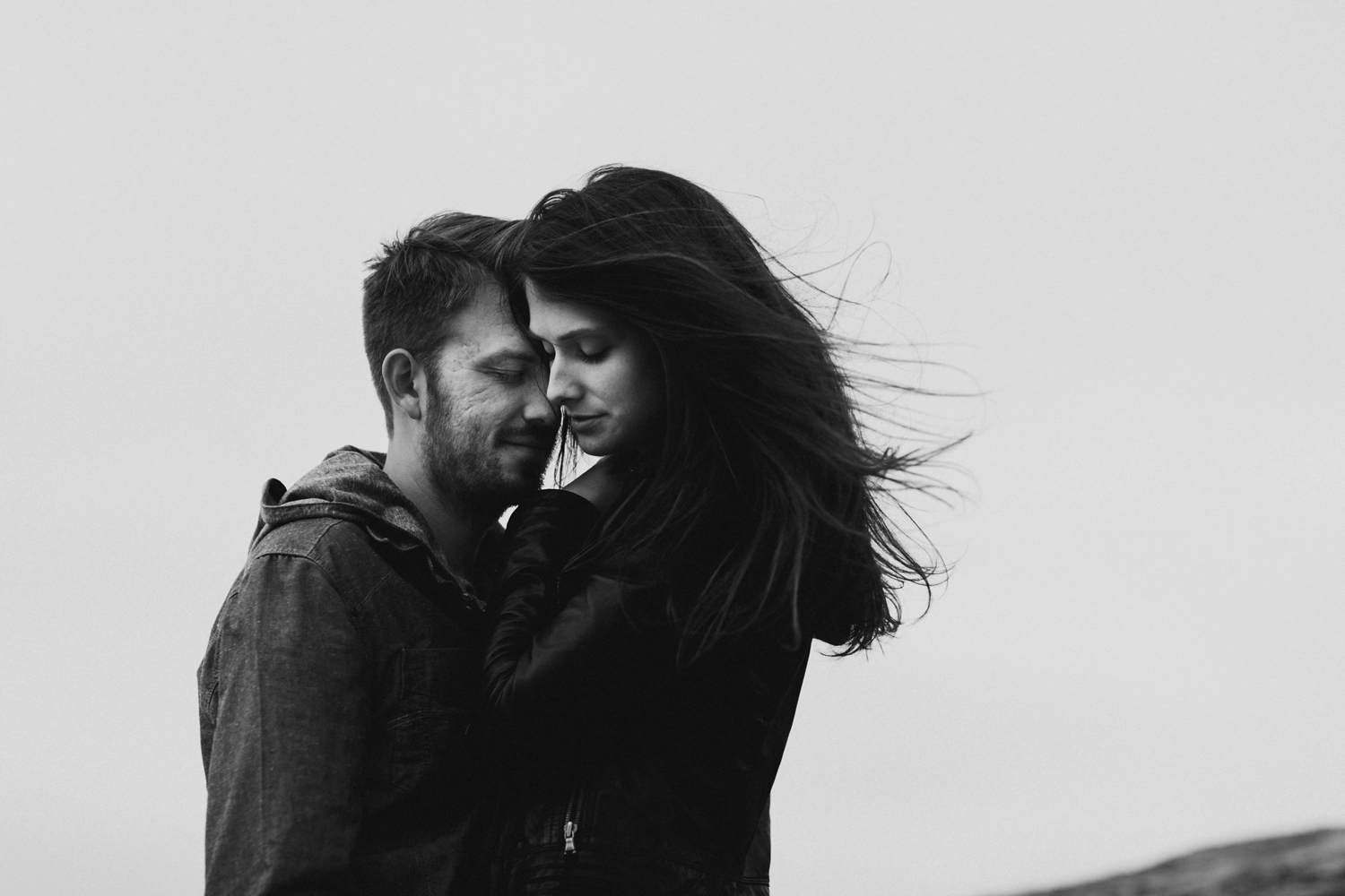 windy costal engagement session