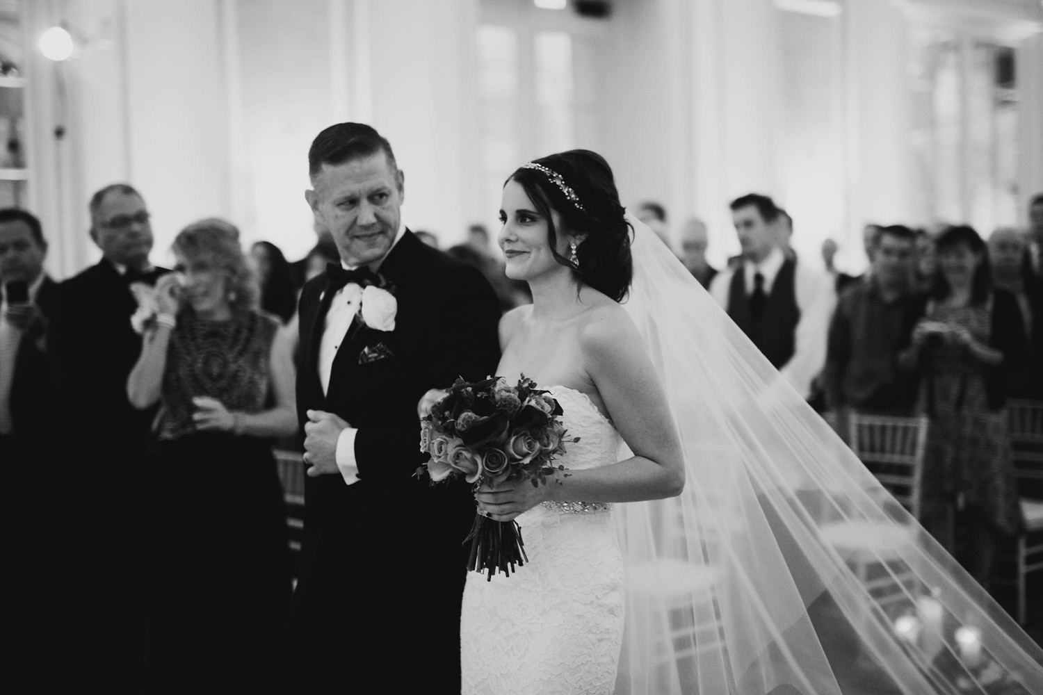 father walking his daughter down the aisle at grand rapids industrial wedding venue