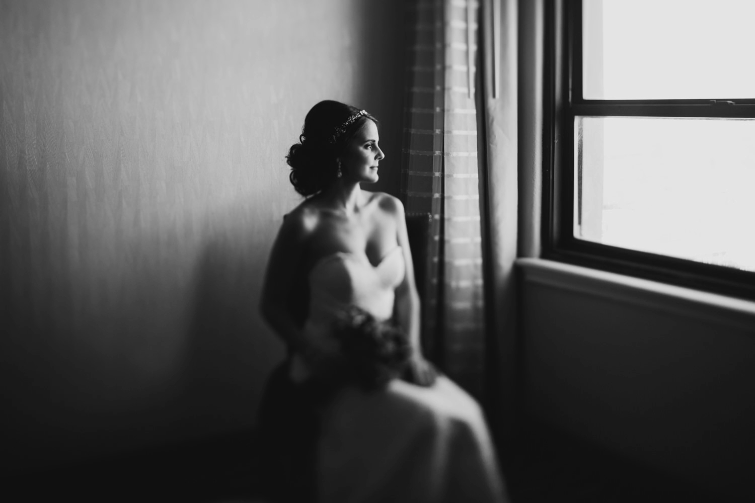 moody bridal portrait in an industrial downtown grand rapids hotel