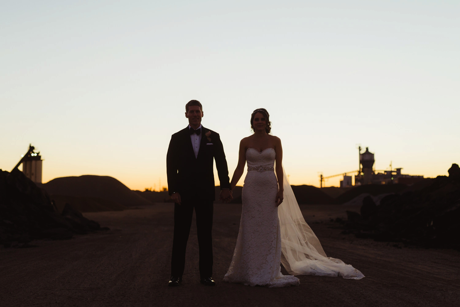 silloute of bride and groom at sunset in downtown grand rapids michigan
