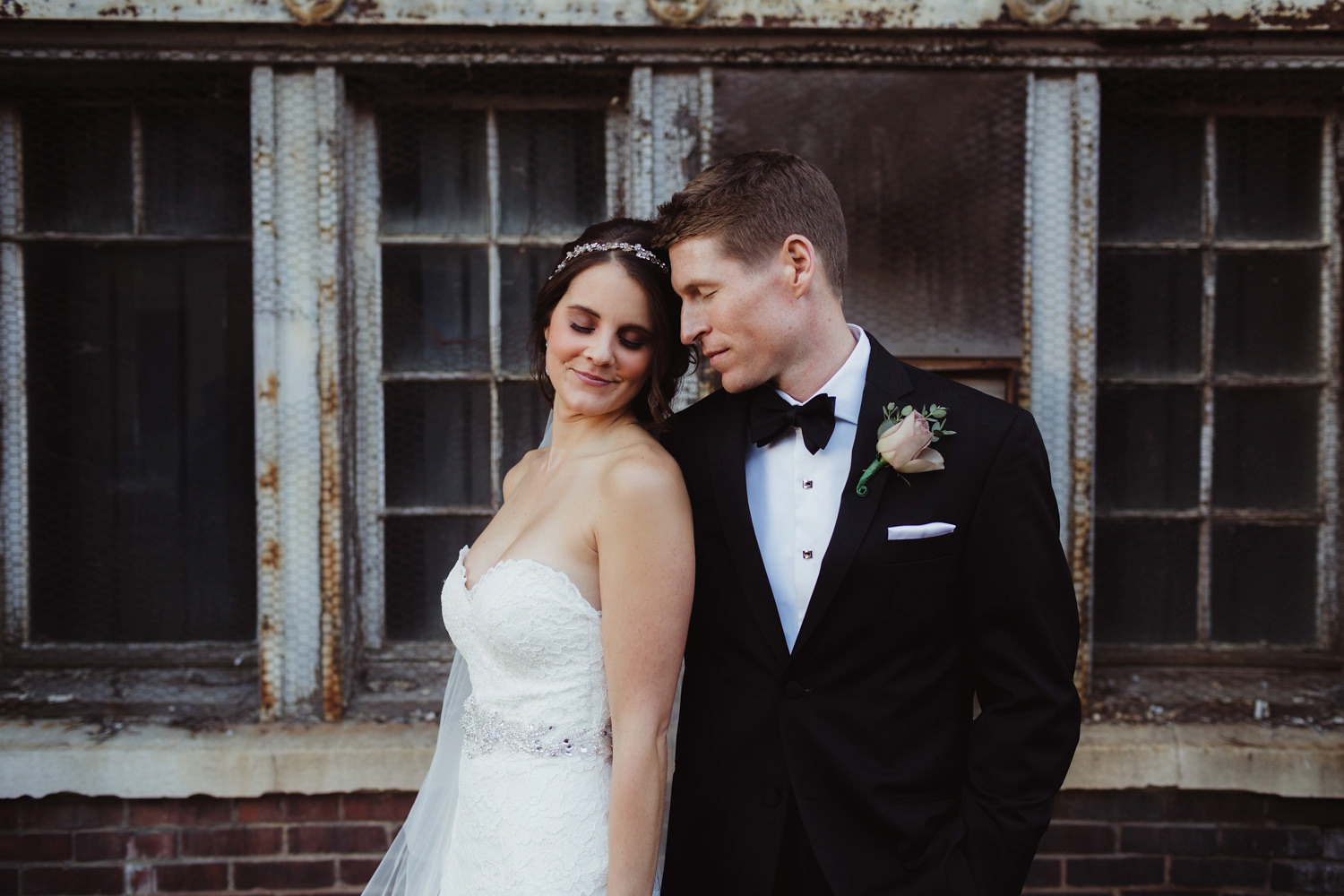edgy and intimate couples portraits in the warehouse district of grand rapids michigan