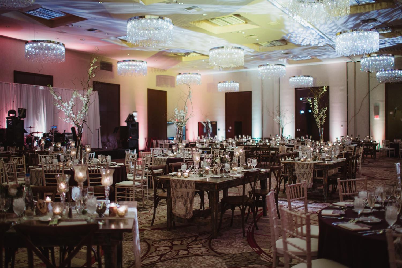 elegant and rustic candlelit wedding reception decor