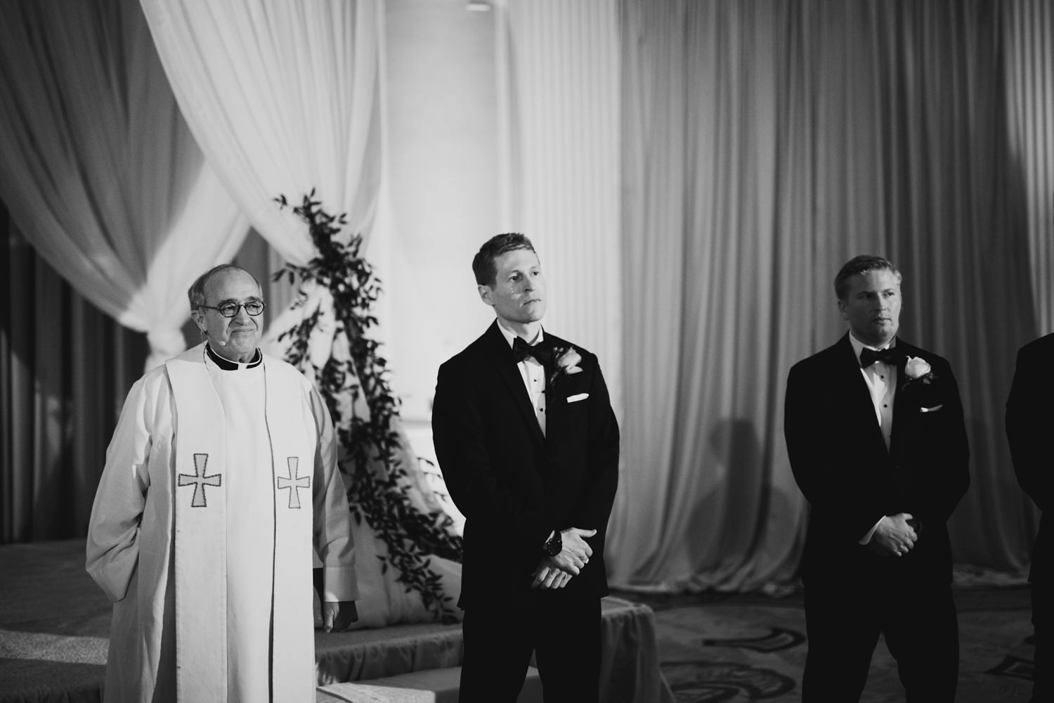 groom crying when his bide walks down the aisle at their pere marquette hotel wedding