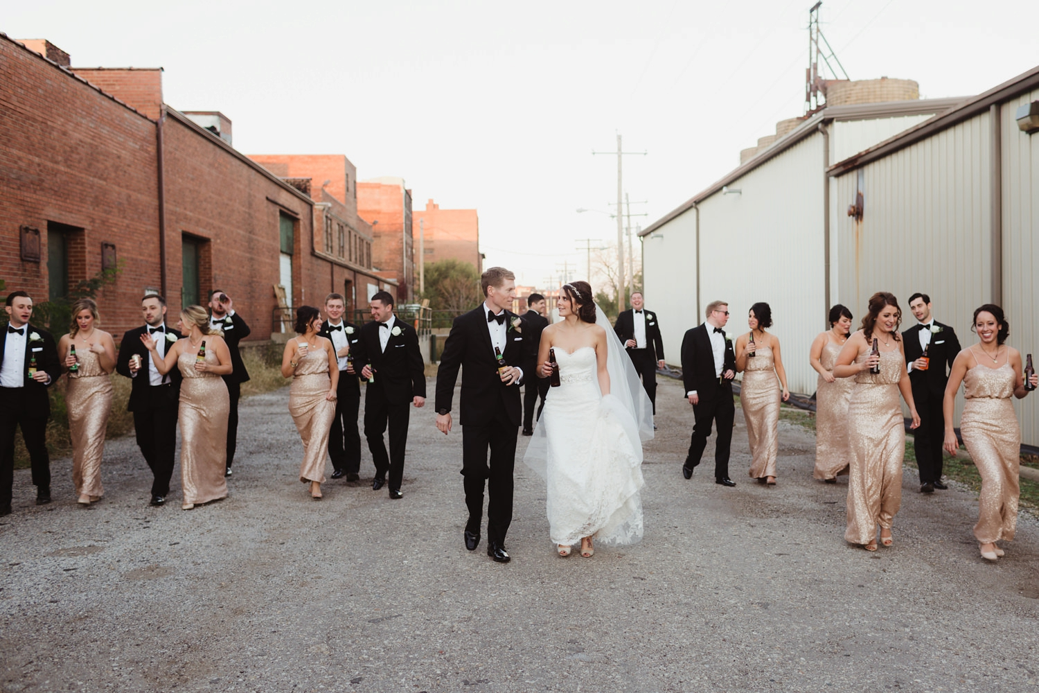 bridal party walking down a back alley for wedding photos in detroit