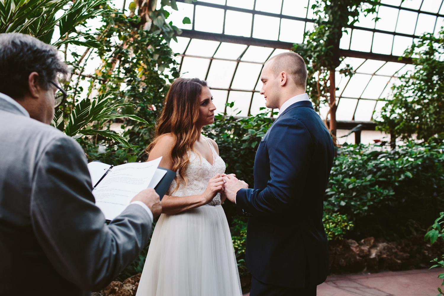 couple exchanging of rings during lincoln park conservatory elopement