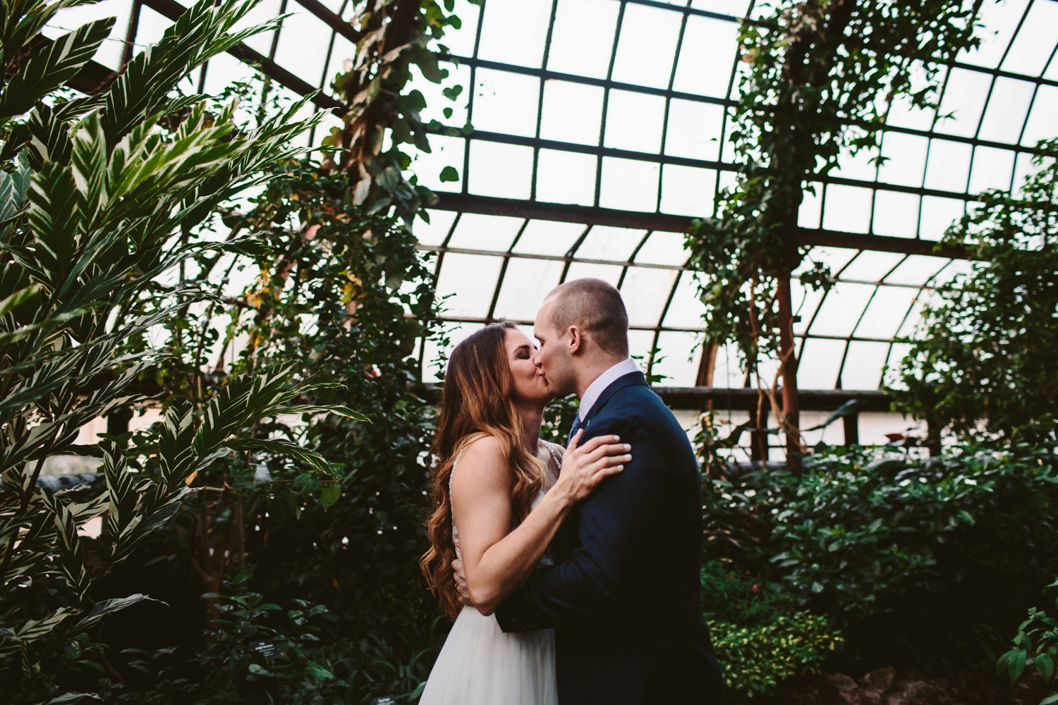 first kiss during elopement in downtown grand rapids michigan greenhouse