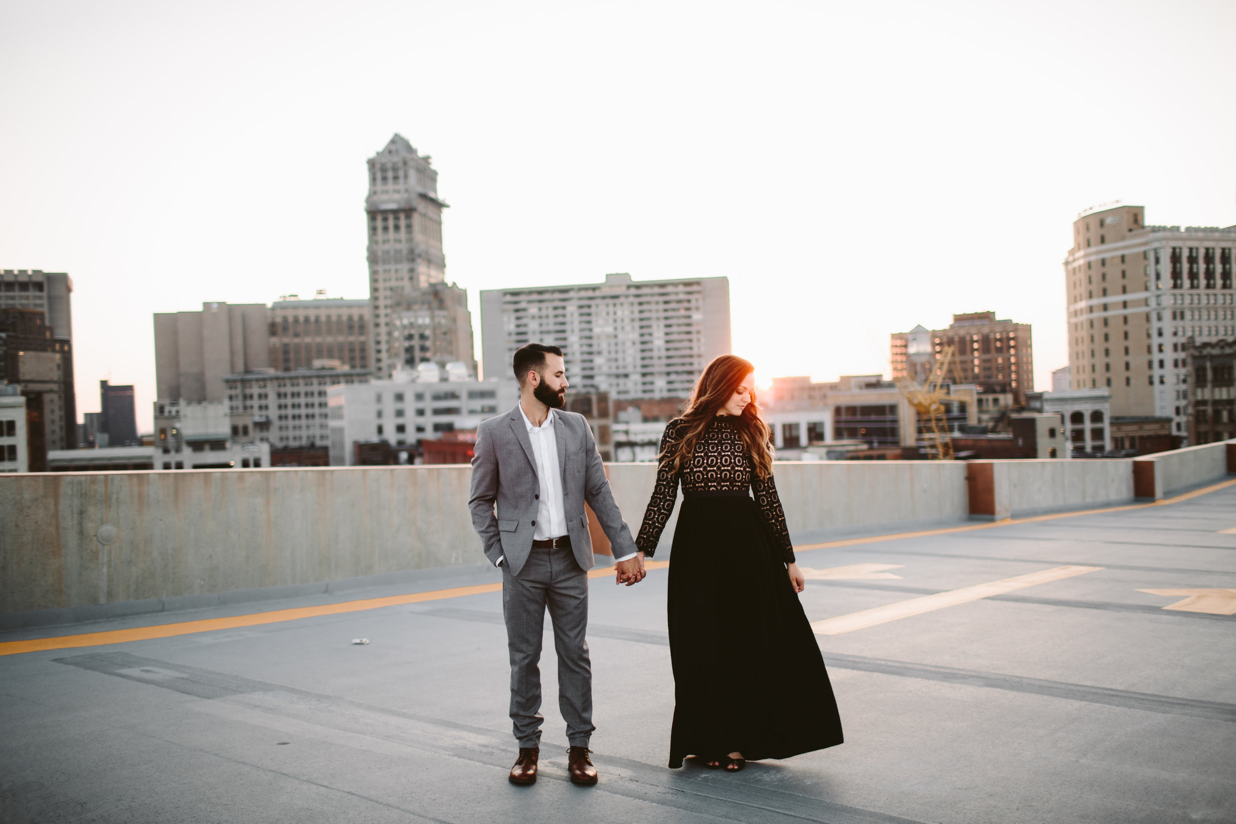 engagement session at sunset on detroit parking garage rooftop