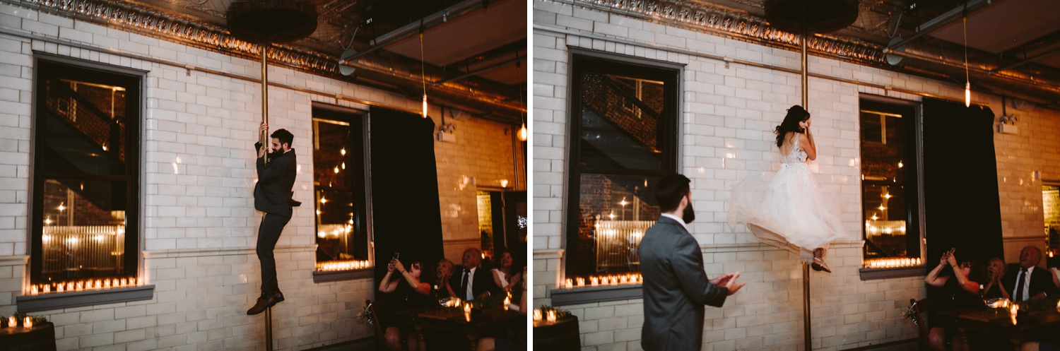 bride and groom sliding down fire pole