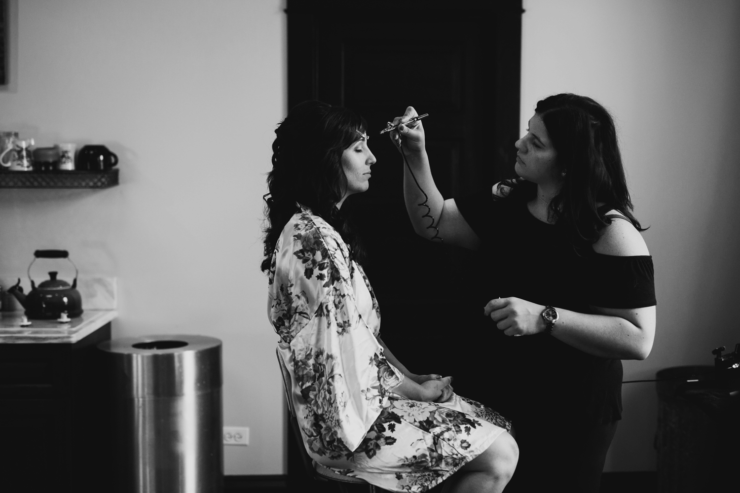 bride getting ready at firehouse chicago wedding venue