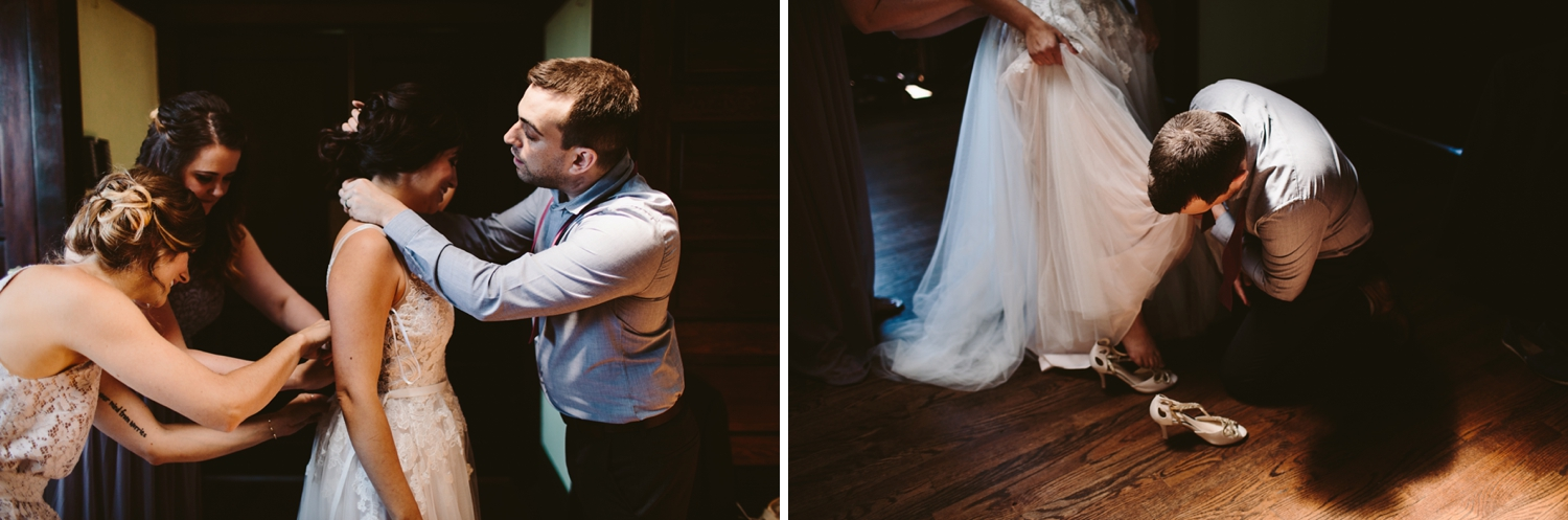 bride getting dressing in firehouse bridal suite