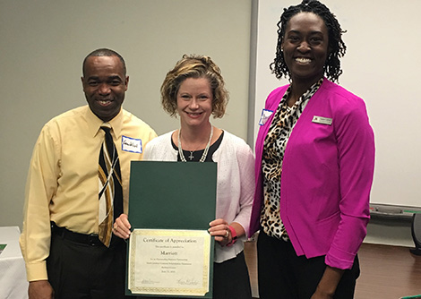 Franklin Morton (left) and Shaina Lockhart (right) from the Columbia Marriott Human Resources Department; Stacy Lever, Richland Area Supervisor.