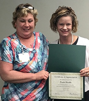 Pat Lee (left), Administrator, Pruitt Health-Columbia; Stacy Lever, Richland Area Supervisor.