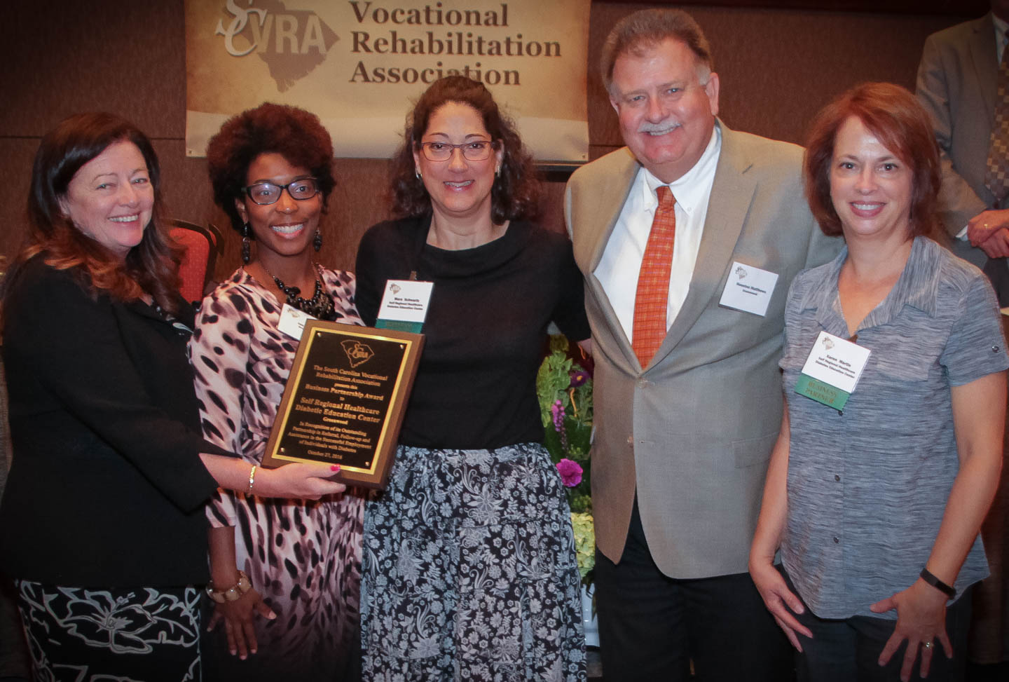 Mara   Schwartz   (center),   Diabetes Program Coordinator  ; and   Karen     Martin   (right),   RN, CDE, CPT  ; from Self Regional Healthcare Diabetes Education Center, receive the SCVRA Business Partnership Award from Dr. Roxzanne Breland (left), Chair of the SC State Agency of Vocational Rehabilitation; Janet Kelly, VR Counselor; and Houston Matthews, Greenwood VR Area Office Supervisor.