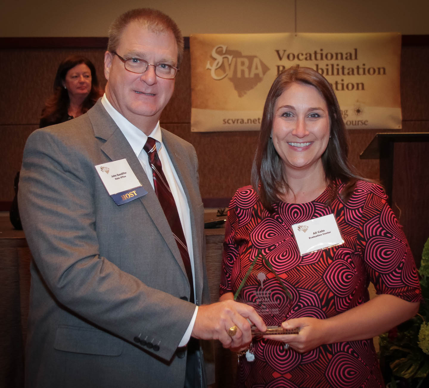 Ali Cato (right), Comprehensive Program Supervisor at the Evaluation Center in West Columbia, receives the Administrator of the Year award from the SCVRA Administrators Association from John Sandifer, SCVRAA President.