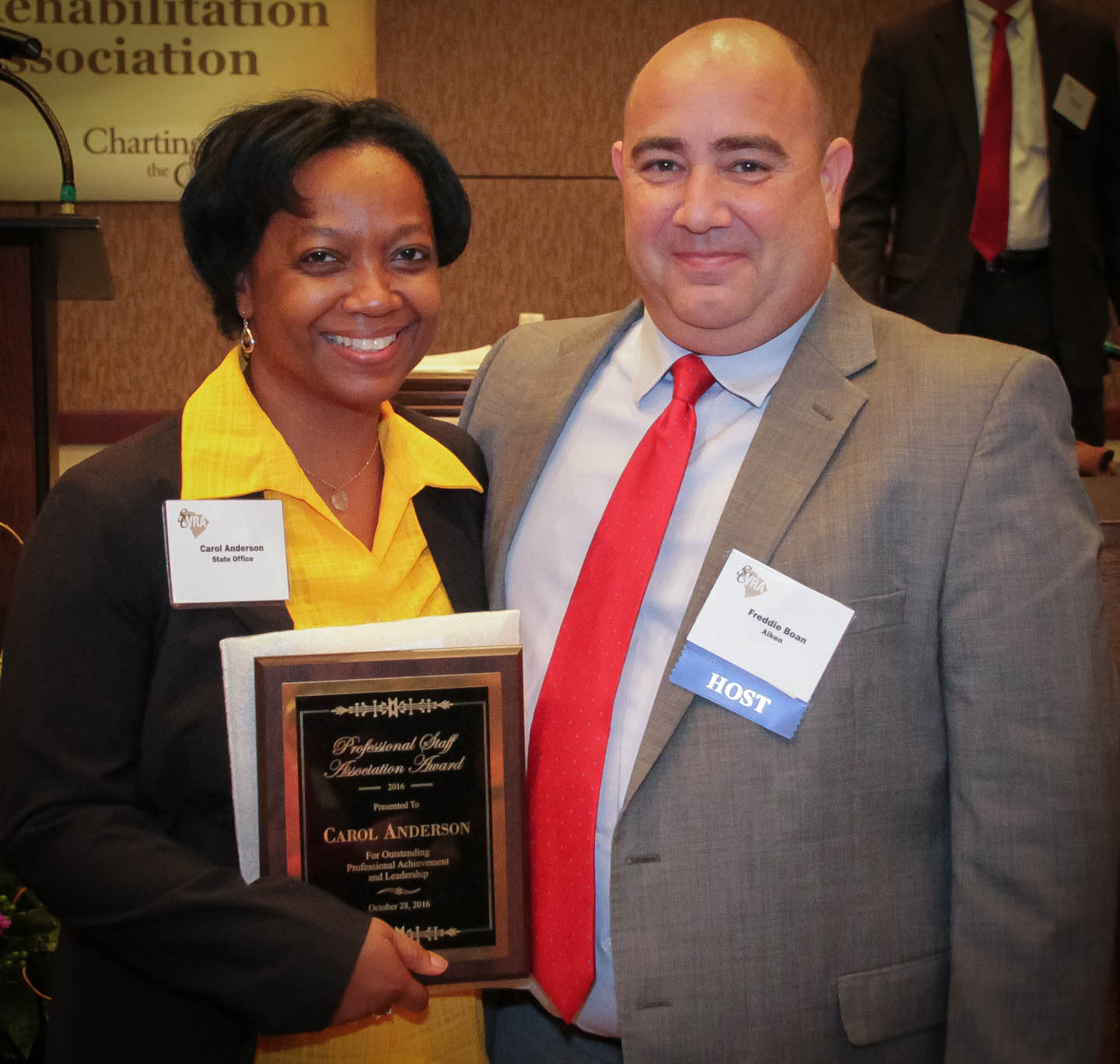 Carol Anderson (left), Area Development Director, accepts the Professional Staff Association Award from Freddie Boan, PSA President.