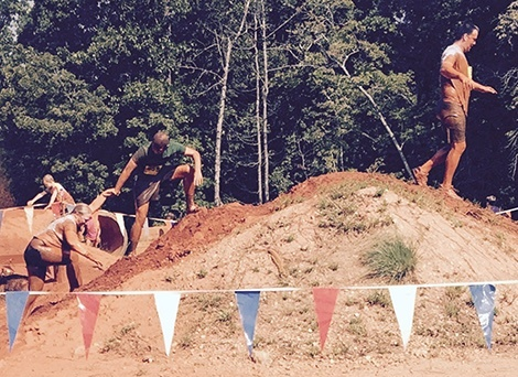 (Left to right): Stephanie Whitlock,  Job Readiness Training Associate; Jeremy Hobbs, Transition Counselor; and Jeff Pruett, Truck Driver; conquer the mud hill.