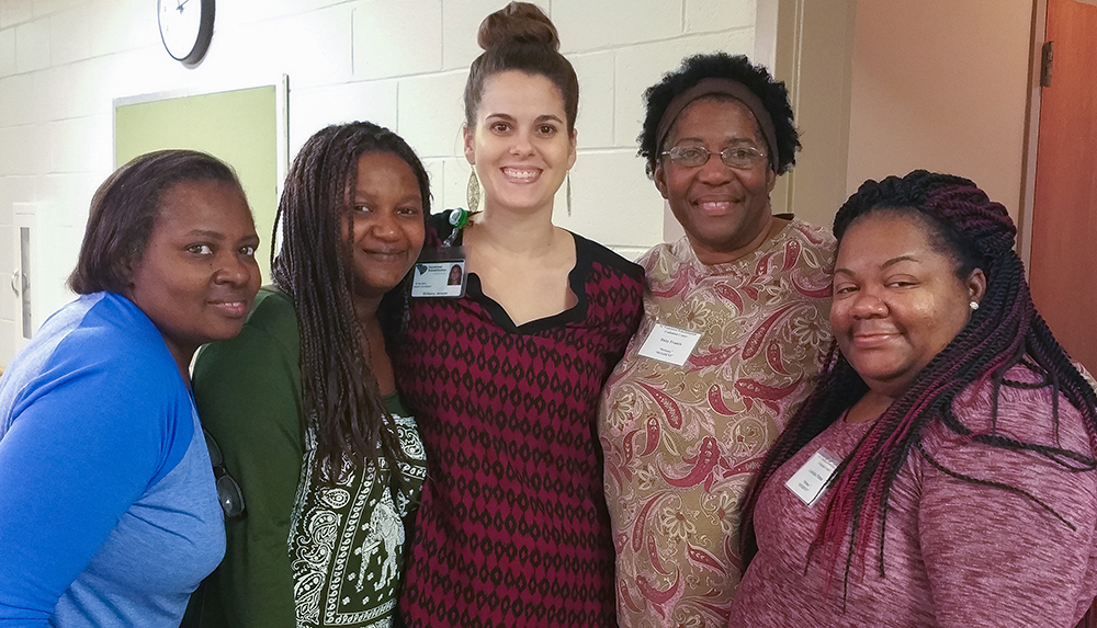 Brittany Jenson, Vocational ACE (center) with clients (left to right) Andrea Fludd, Kenisha Hann, Daisy Francis, and Kekeisha Patton.