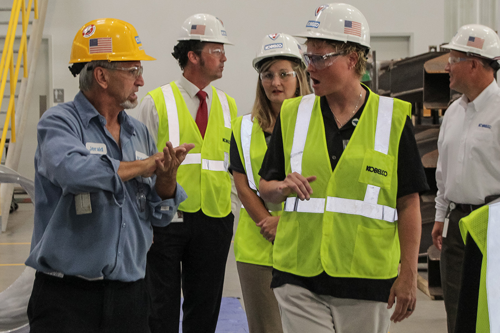 Jerald Grimes (left) explains part of the construction and welding process at Kobelco to Amelia England,Employment Coach and Counselor for the Deaf and hard of hearing.