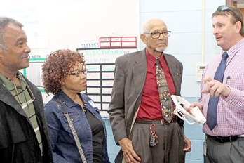 Seneca Mayor Dan Alexander, right, a business development specialist for South Carolina Vocational Rehabilitation's Oconee and Pickens office, describes the services provided to local pastors, from left, Anthony Scott, Yvonne Scott and William Cureton Sr. Rex Brown | The Journal