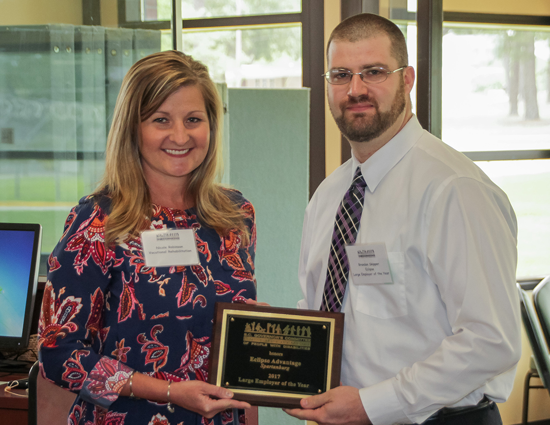Brandon Skipper (right) of Eclipse Advantage in Spartanburg, accepts the Large Employer of the Year Award from Nikki Robinson, representing the Spartanburg Mayor's Committee and the SC Vocational Rehabilitation Department's Spartanburg area office.
