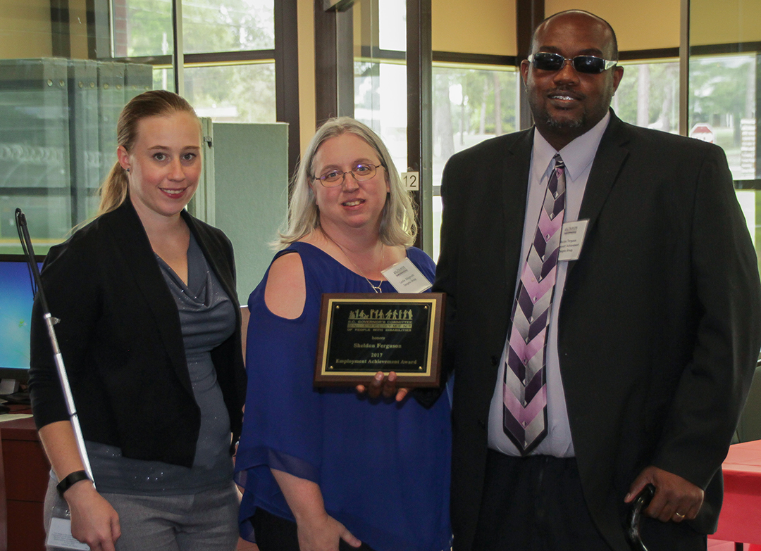 Sheldon Ferguson (right) accepts the Employment Achievement Award. On the left is Cali Sandel of the SC Commission for the Blind and in the center is Leslie Sibigtroth of Insignia Group, Ferguson's employer.