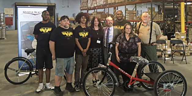 Left to right: VR clients Byron Bromell, Lonnie Cartrette, Shawn Hernandez; Tania Appel, VR Business Development Specialist; Wayne Sosin, President, Worksman Cycles; VR clients Xavier Williams, Daniel Hires, Linda Ferguson.