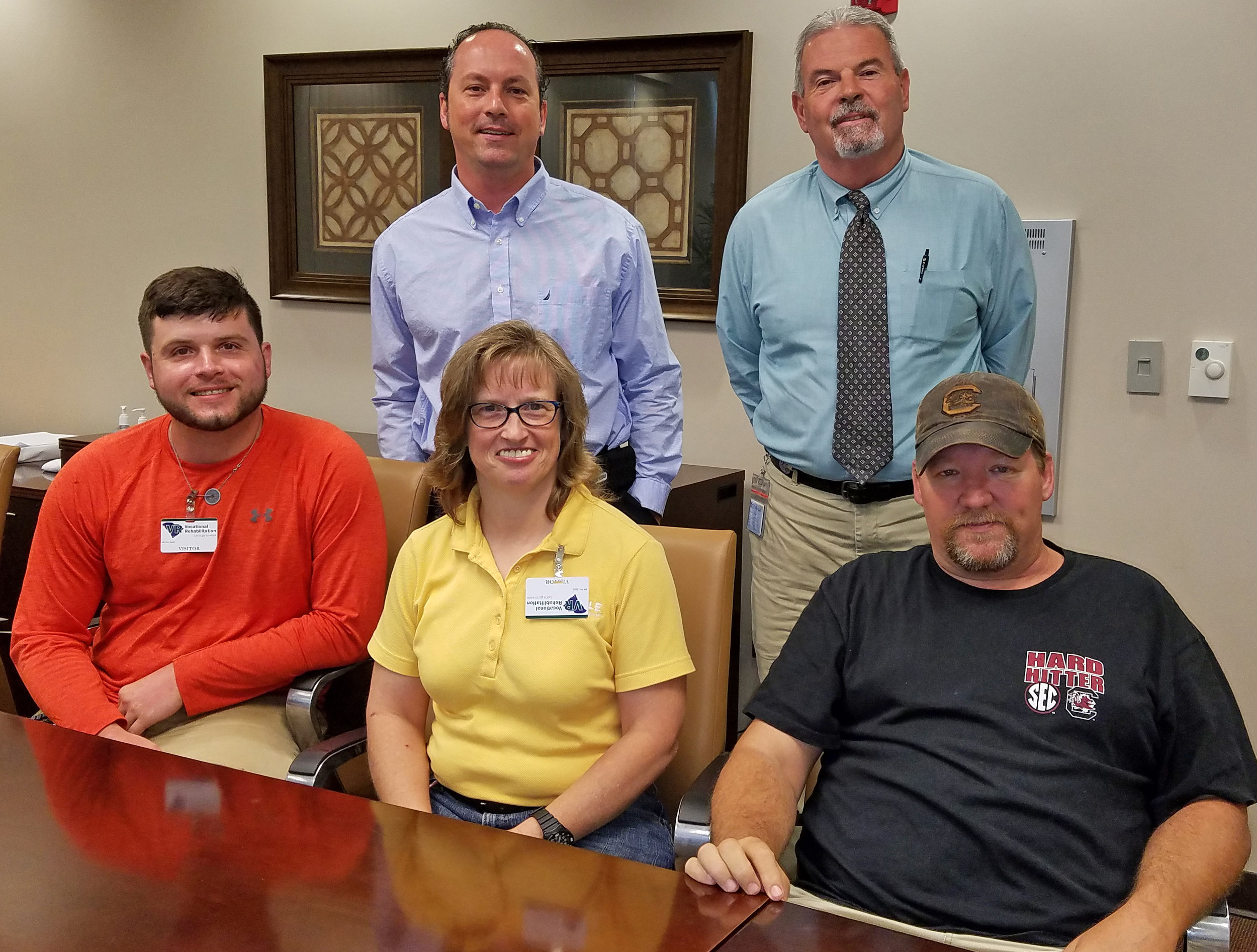 Front row, left to right: Former clients Justin Smith, Melanie Miller and Terry Manus are employed by Sloan Construction in the Upstate. Back row: Ryan Skinner, VR Business Development Specialist and Jay Weisner, Center Manager and OSHA 10 Trainer.