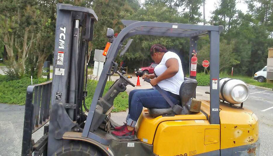 VR client Nastasia Winfrey navigates through a course as part of earning her forklift certification.