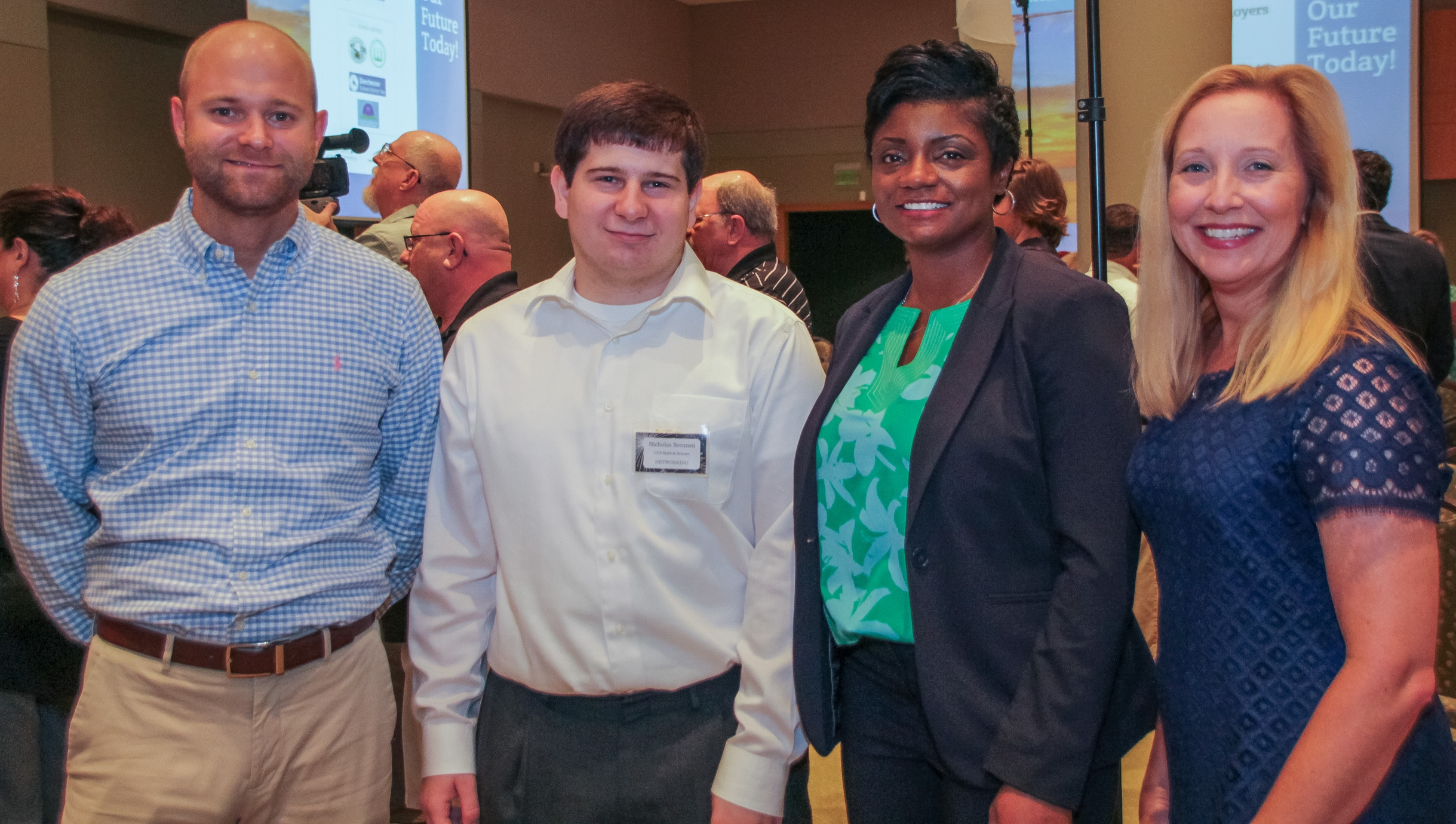 """Left to right: Eric Romanowski, VR Counselor; Nicholas """"Nick"""" Brennan; Felicia W. Johnson, VR Interim Commissioner; Cathy Clower, VR Regional Business Development Specialist.Nick is a recent graduate of Charleston Charter School of Math and Science and a 2017 Charleston Regional Youth Apprentice. He will be hired as an apprentice with Trident Technical College's Computer Networking Apprenticeship Program."""