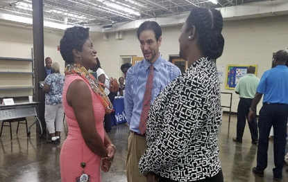 VR Interim Commissioner Felicia Johnson and Area Development Director Gail Murray speak with an attendee at the Second Annual Pee Dee Reentry Job Fair & Expo.