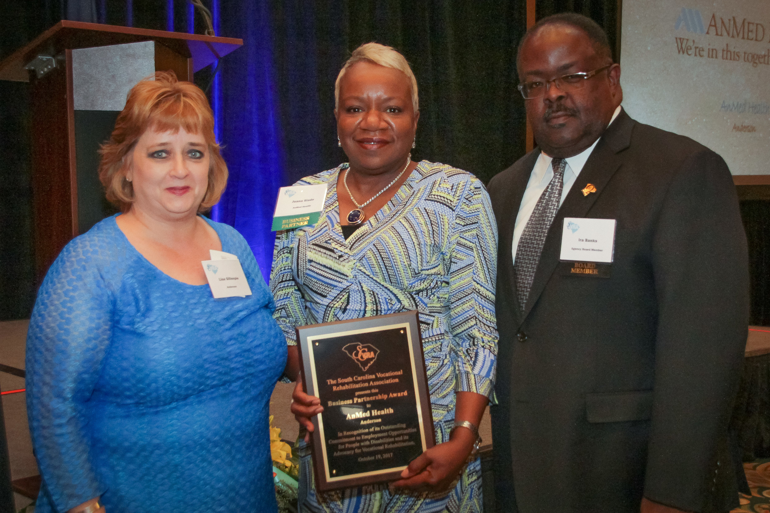 Juana Slade (center), Chief Diversity Officer at AnMed, receives the SCVRA Business Partnership Award from Lisa Gillespie (left), Anderson Area Supervisor, and Ira Banks, SC State Agency of Vocational Rehabilitation Board Member.