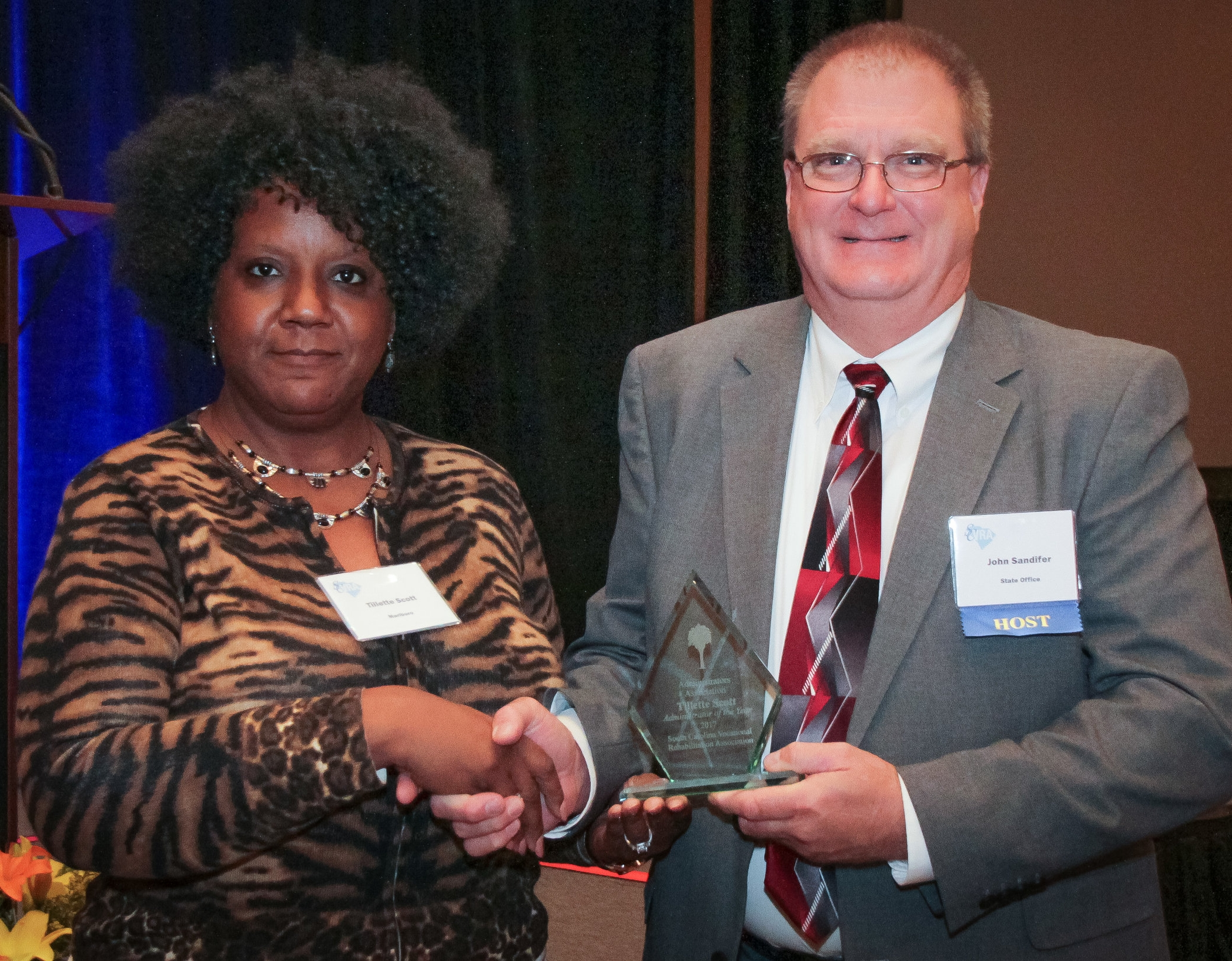 Tillette Scott, (right), Marlboro Area Supervisor, receives the Administrator of the Year award from the SCVRA Administrators' Association from John Sandifer, SCVRAA President.