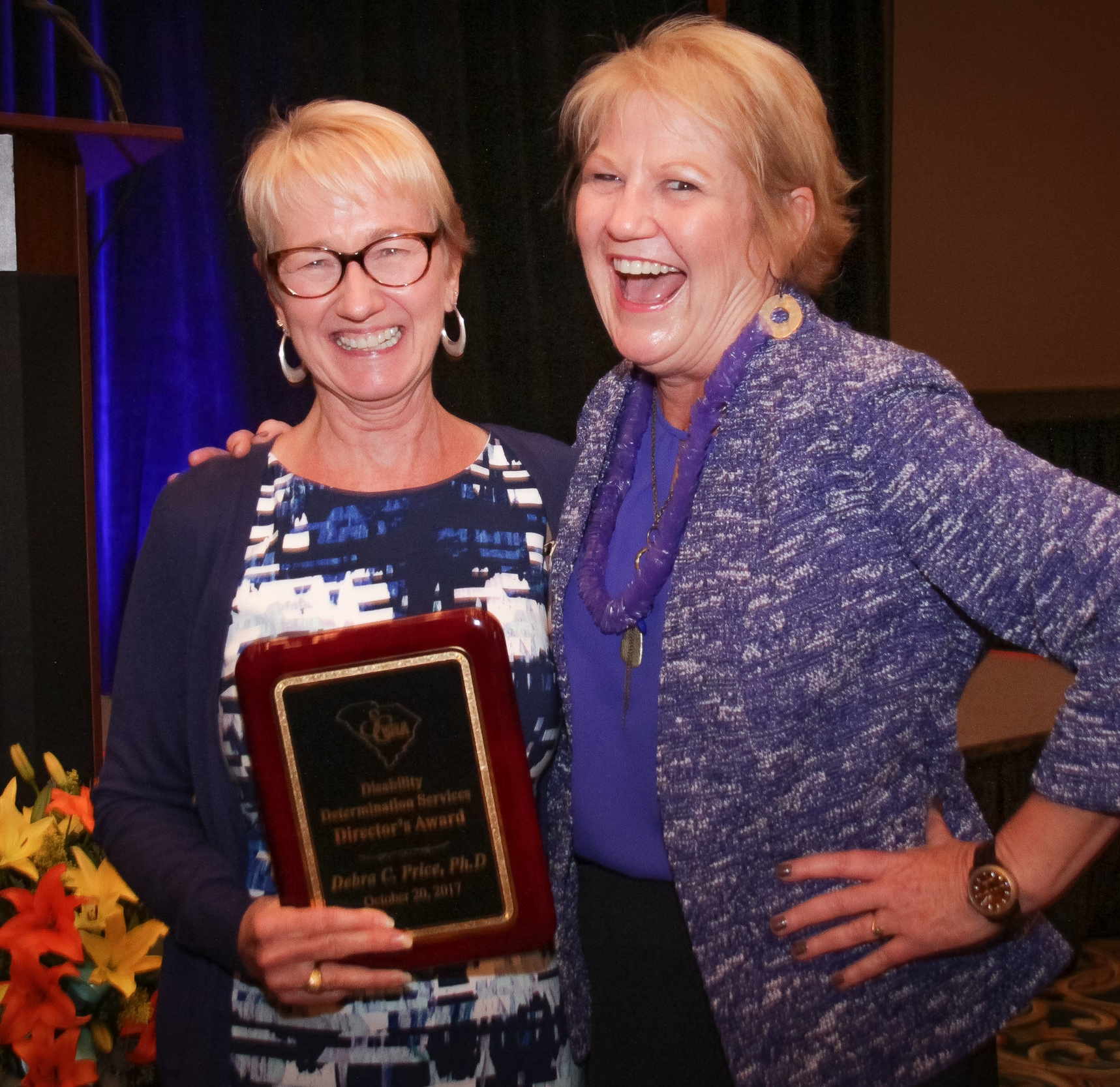 Debra C. Price (left), Ph.D, Disability Determination Lead Psychological Consultant, accepts the DDS Director's Award from Shirley Jarrett, Director, Disability Determination Services.