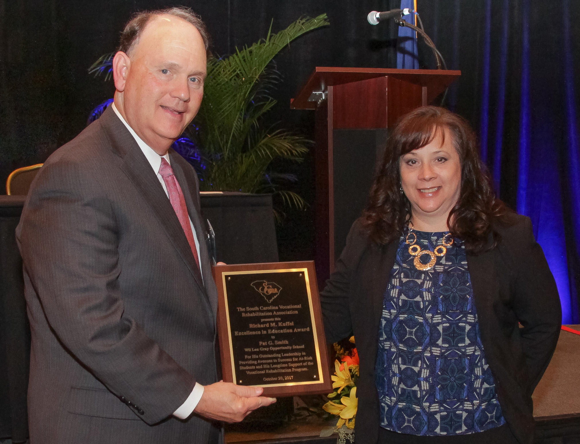 Pat G. Smith (left), Director of the Wil Lou Gray Opportunity School in West Columbia, receives the Richard M. Kuffel Excellence in Education Award from Laura Spears, VR Transition Services Coordinator.