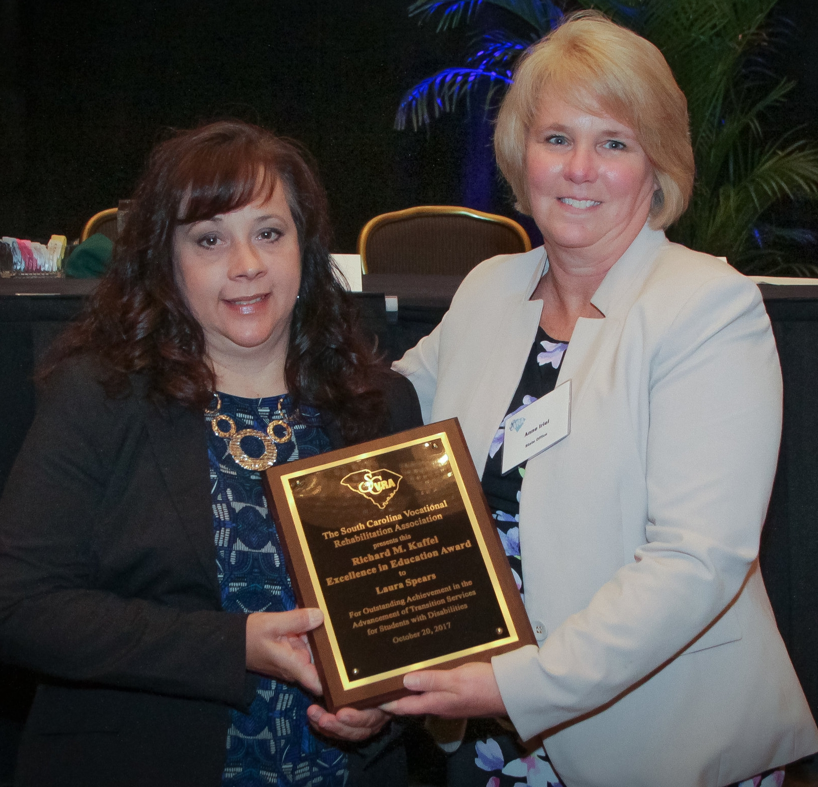 Laura Spears (left), VR Transition Services Coordinator, receives the Richard M. Kuffel Excellence in Education Award from Anne Iriel, VR Assistant Commissioner.