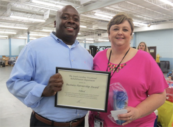 Marvin Starks (left), Operational Manager at Nibrol, accepted the Business Partnership Award. He is pictured with Center Manager Darlene Jones.