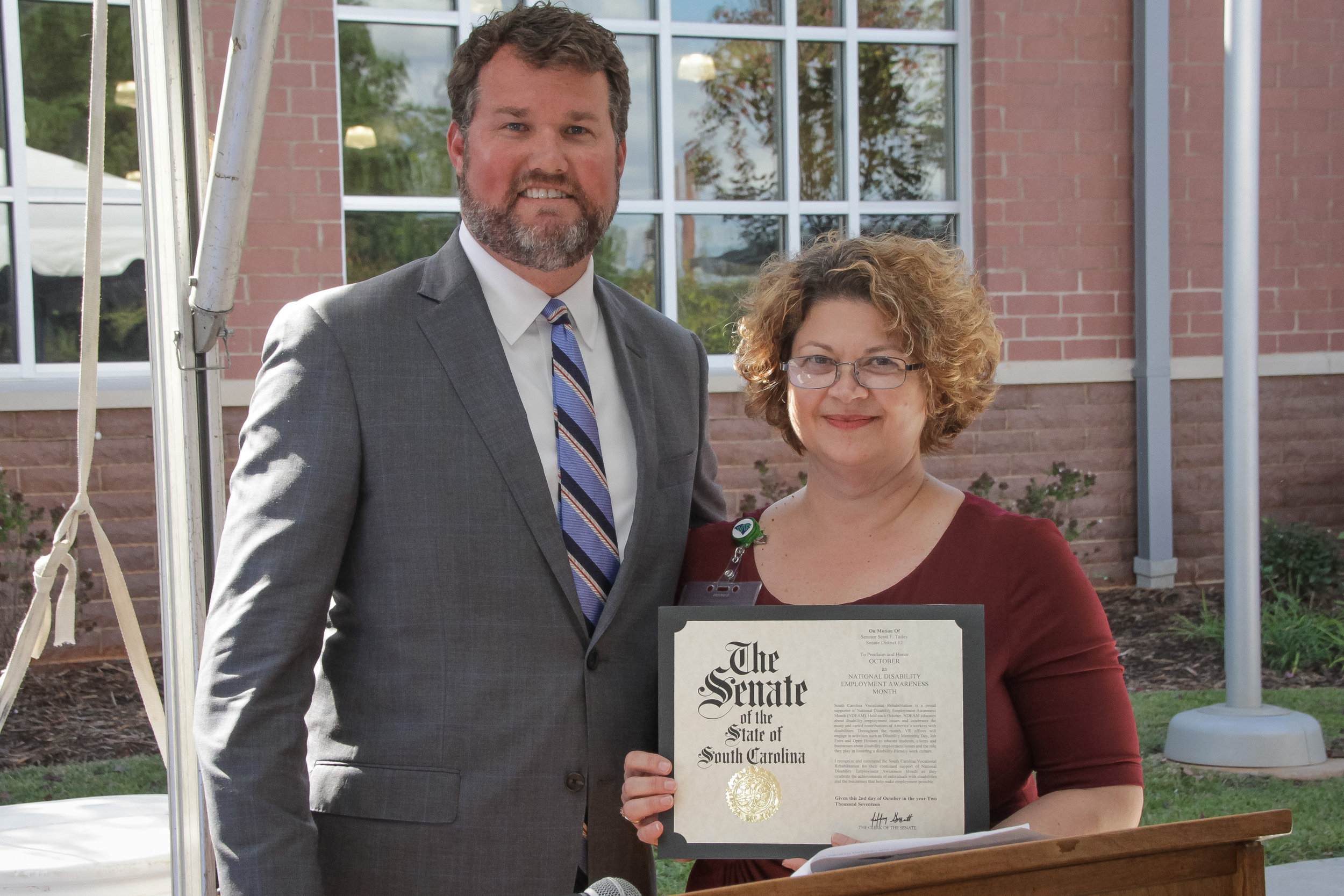 Senator Scott Talley presents Lyman Area Administrator Jennie Thomas with the state senate proclamation for National Disability Employment Awareness Month (NDEAM).