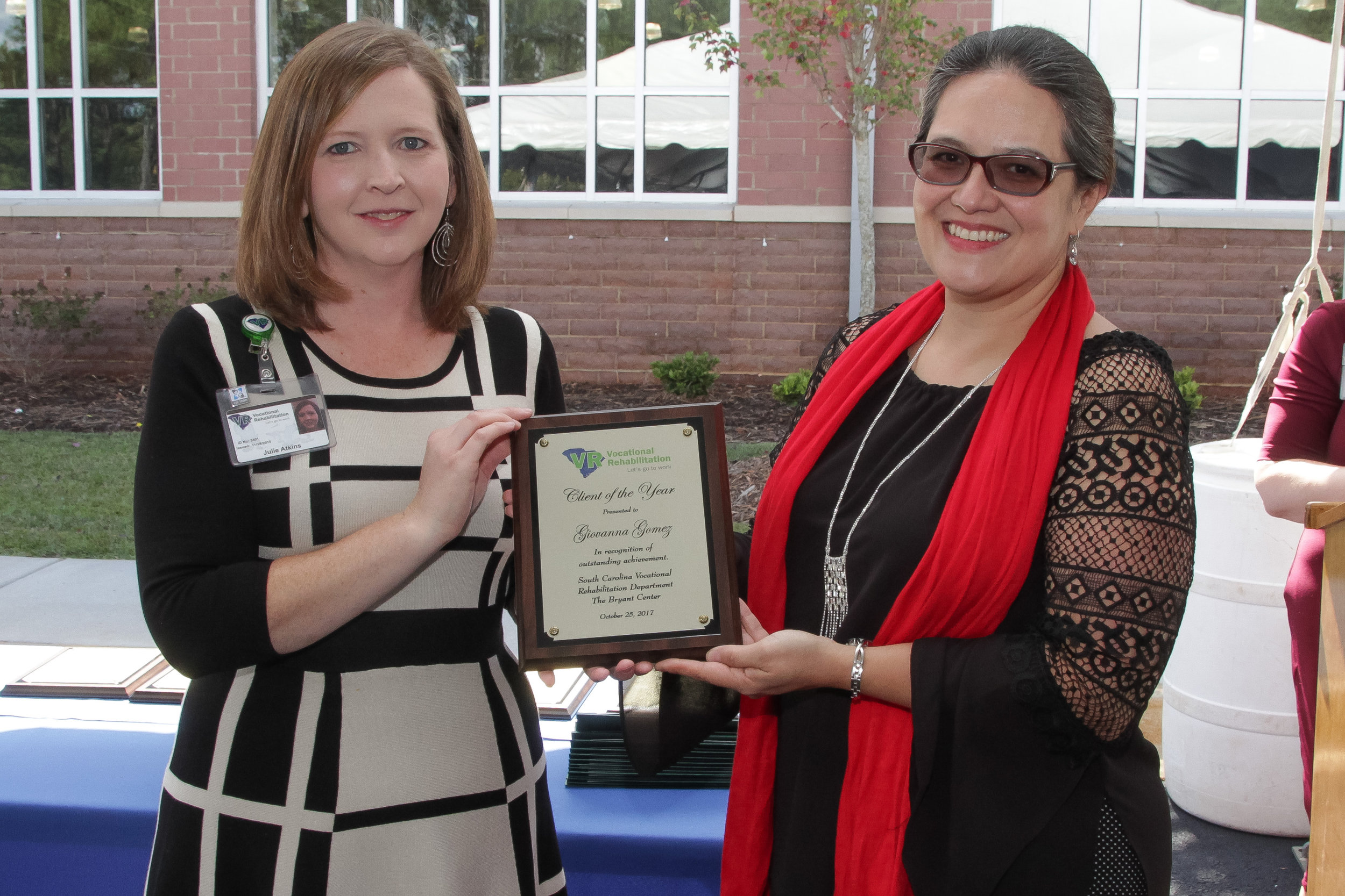 Former VR client Giovanna Gomez (right) receives the Lyman Office Client of the Year award from Julie Atkins, Area Client Services Manager.