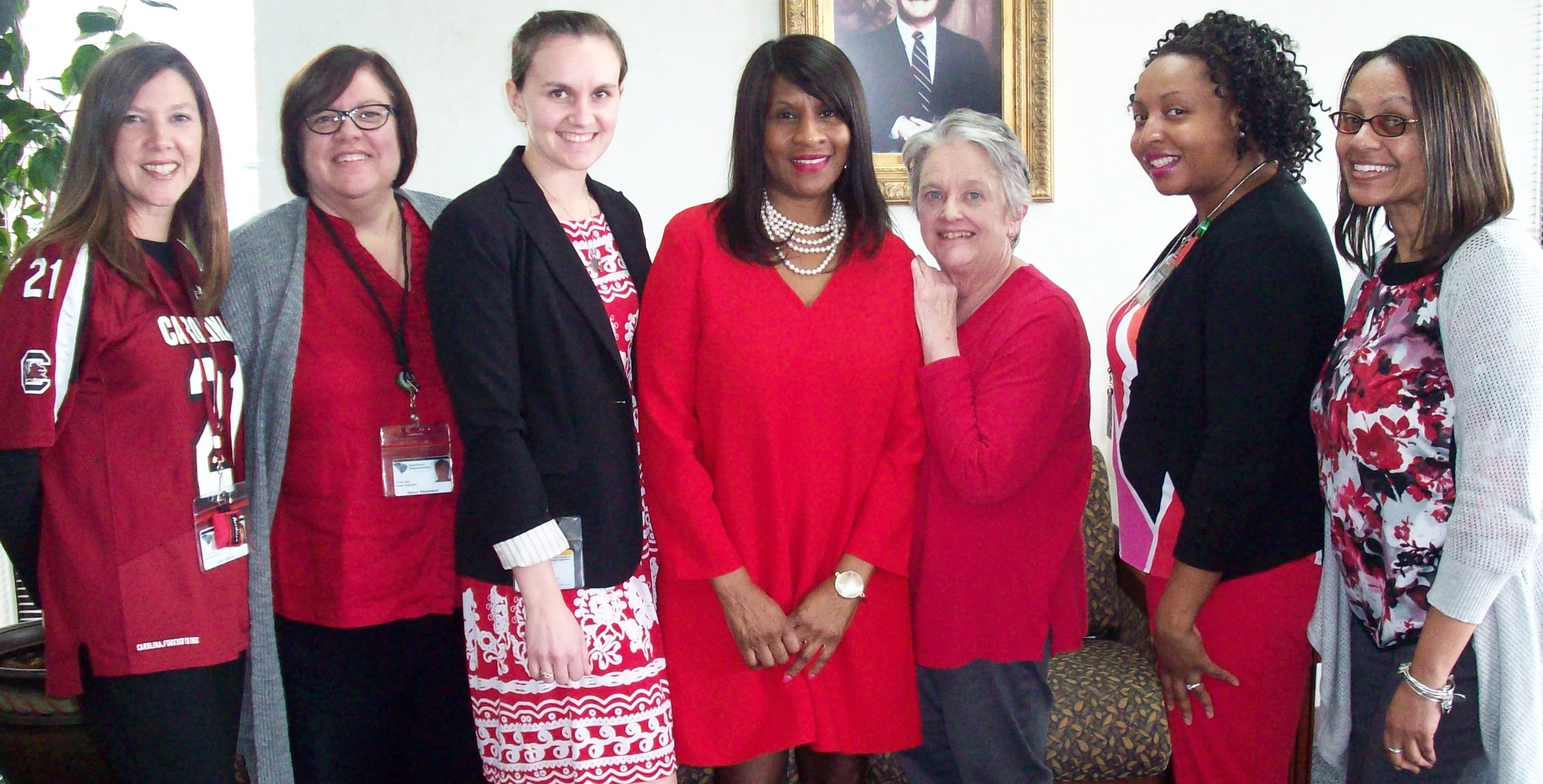 Staff at the Berkeley-Dorchester office wear red to support the awareness of heart disease in women.
