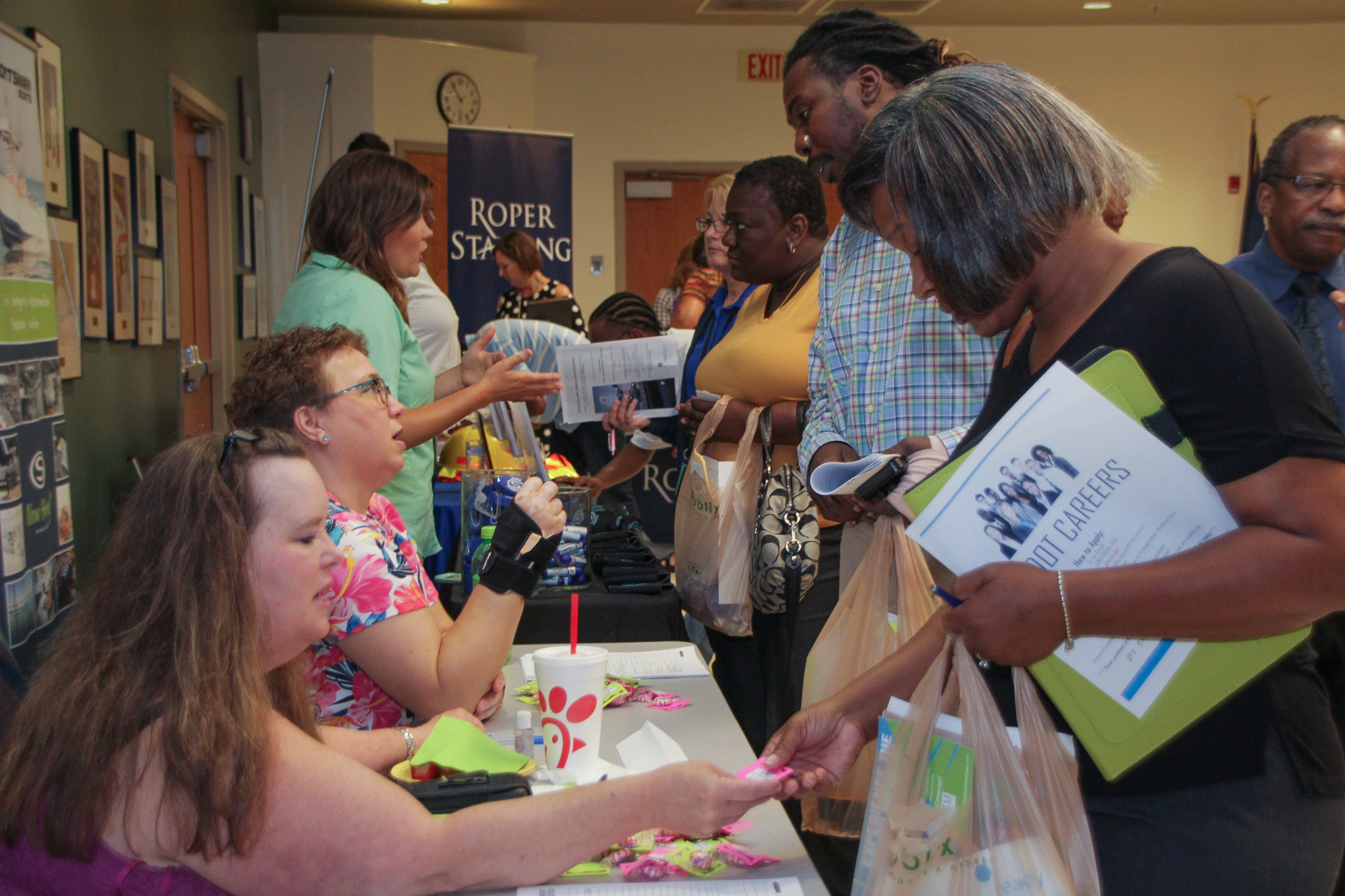 Employers meet with and interview job seekers at the South Coast Re-entry Job Fair.