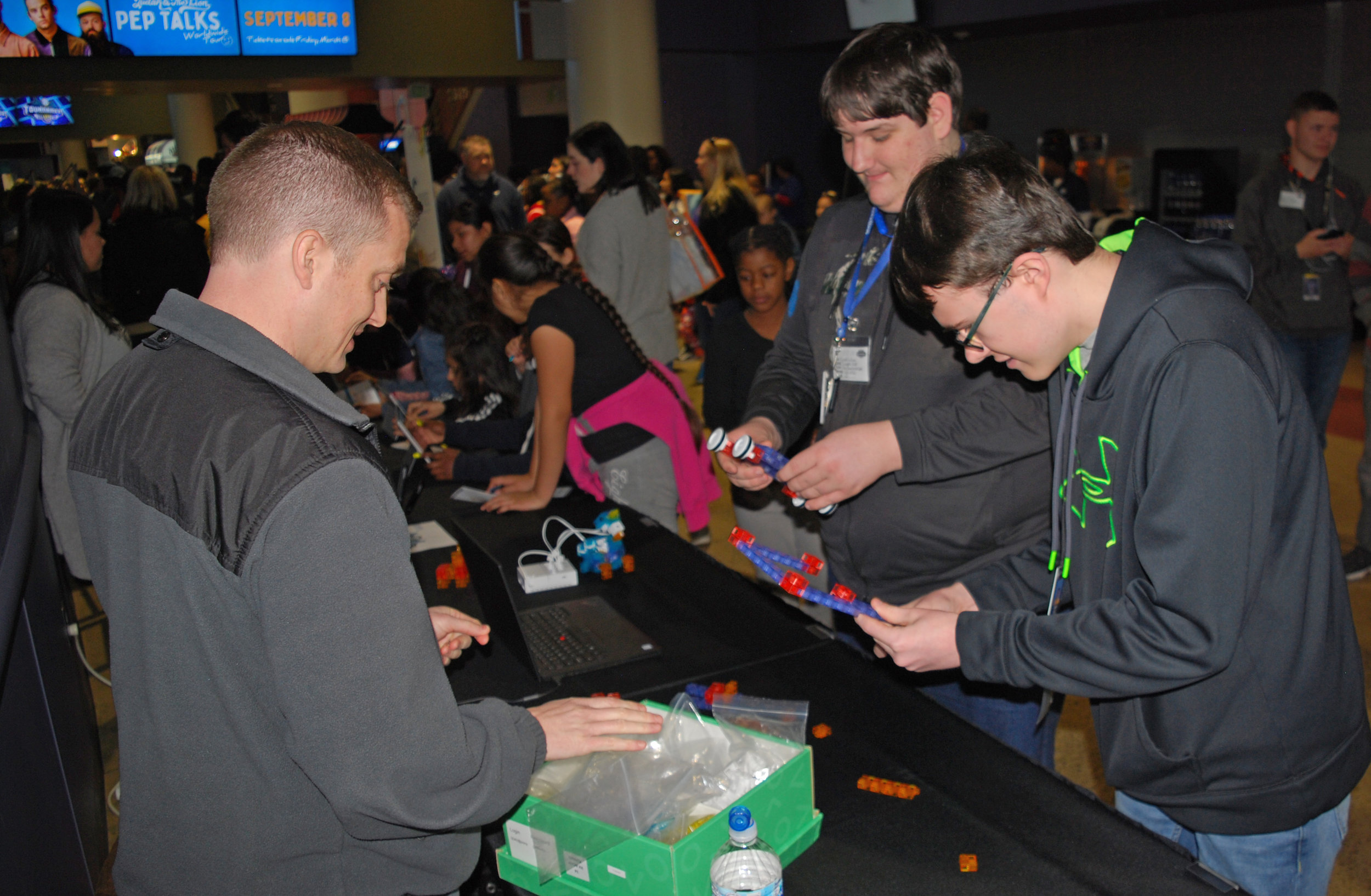 """Students assemble small robots as part of """"STEAM Day"""" activities."""
