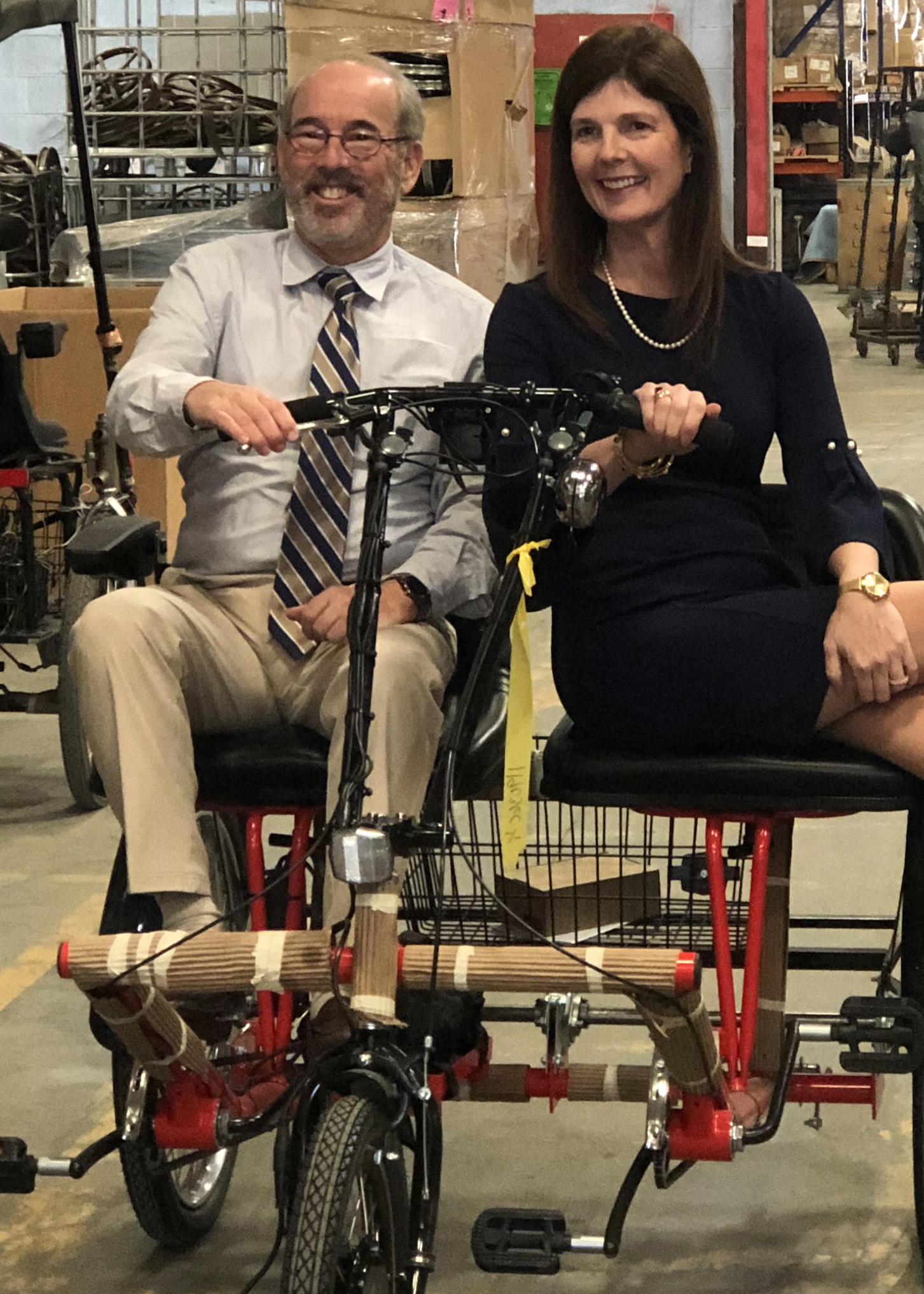 Wayne Sosin, President of Worksman Cycles, and Lt. Gov. Pamela Evette try out one of the company's tricycles.