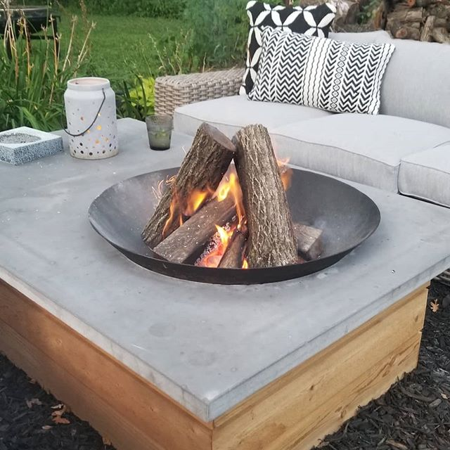 I had an idea for the design of this table after seeing a gas concrete firepit table online....it lacked something for me & I love the idea of a real fire. I asked my boyfriend if what I wanted was possible & he said he could make it happen. This was the final design & I love how it turned out! Cedar shiplap base which will weather nicely, poured concrete top (which I helped mix!) & a steel firepit bowl. 😍🥰 #concretedirepittable ##modernrusticdesign #my1stfurnituredesign #firepit #concrete #amazinglytalentedboyfriend #firepittable