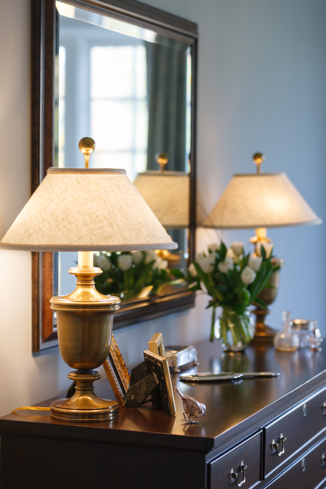 dresser-with-brass-lamps-blue-bedroom.jpg