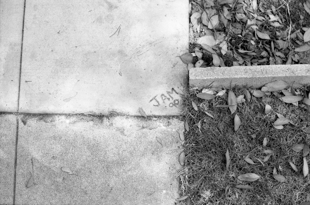 Concrete tag in Ocean Beach, California (1996)
