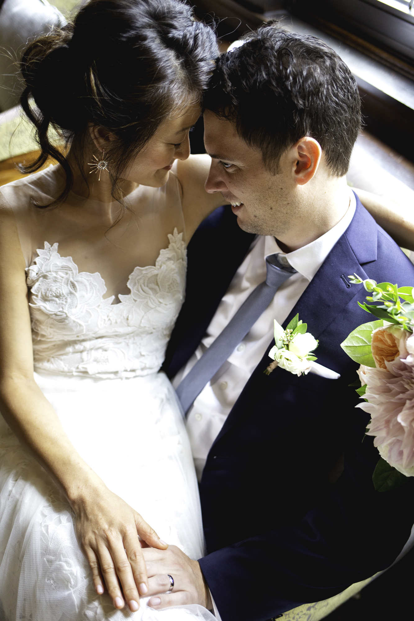 Sophie and John share a moment as newlyweds at  The Minneapolis Club .  Wedding by:  Nicole McCoy