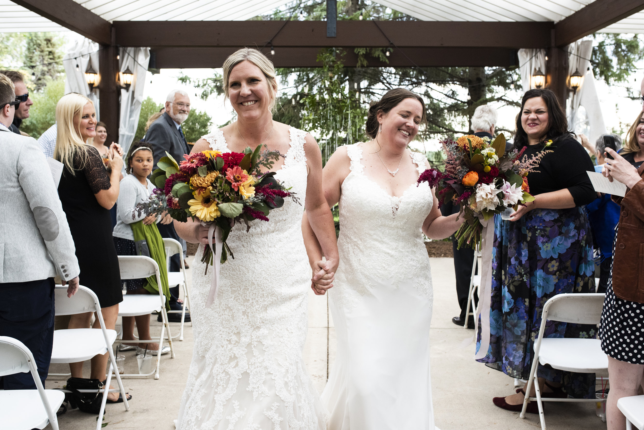 Amy and Sam in a blissful moment as they walk down the aisle as newlyweds at  Breezy Point Resort .  Wedding by:  Melissa Hesse