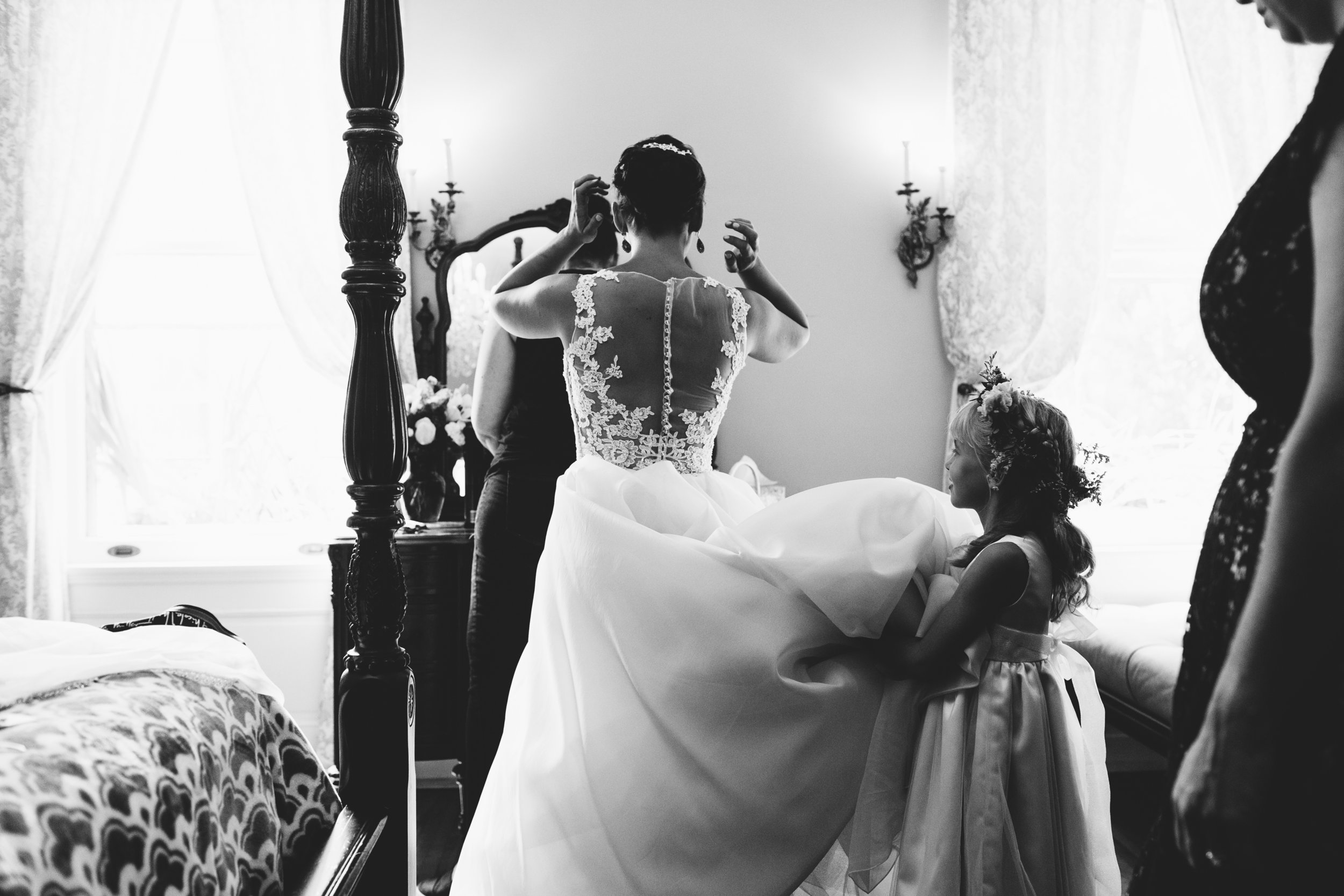 Jeanie puts on the final touches of her wedding day attire.  Wedding by:  Jess Ekstrand